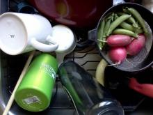 dish drain with vegetables, mug, water bottle