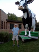 Pat posing with giant cow statue