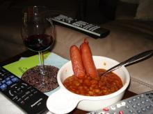 Beans & weenies, with glass of two buck chuck and TV remotes.